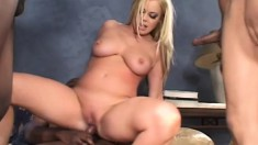Four black guys share the busty blonde's tight holes and she loves it