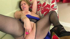 Curvaceous British milf Lily feeds her hungry snatch a pink dildo