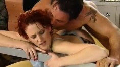 Short haired redhead in black stockings rides her man like a champ