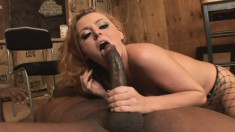 Gorgeous redhead milf Sophie Dee has a black stallion plowing her ass