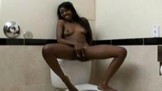 Attractive black cutie has wild sex with her boyfriend in the toilet