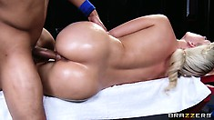 Team masseur takes the time to massage every orifice on sporty blonde's body