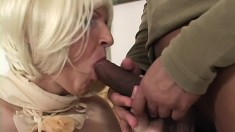 Sensuous blonde mature plays with a big dildo and fucks a black cock