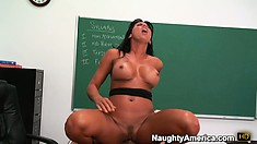 She rides on his rod on top of the desk and bounces her hot ass on him