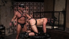 Ripped slave in a gimp mask gets his ass plugged by his tattooed master