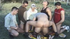 Lustful Brunette Enjoys Hardcore Sex With A Gang Of Studs In The Park