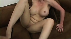 The busty lady spreads her legs inviting his shaft to explore every corner of her twat