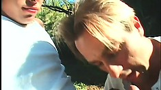 Blonde hunk meets his lover in the woods and share some cock