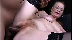 Cock-hungry MILF knows how to work a couple of cocks at the same time