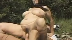 Horny mature lady blows a dick and gets her holes banged rough outside
