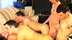 Five lustful gay friends get together on the couch for a wild orgy