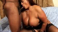Voluptuous caramel woman has a huge black dick pleasing her twat like she desires