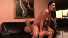 Sheila Marie and her lesbian partner having fun with a strap-on dildo