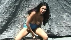 Arlanza gets out her chair and dildo to fuck herself and sits on it outside