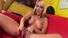 Blonde babe Jana Cova shoves her big red dildo up her slick twat