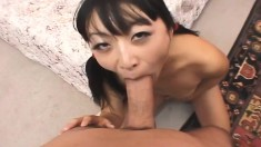 Skinny Asian broad slurps up a big dick and gets her cunny drilled