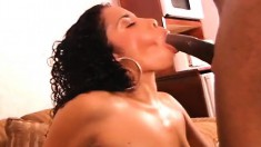 Busty and horny ebony slut spreads her long legs for a huge black pole