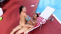 Seductive babe drops her pink bikini and fucks a big dick by the pool