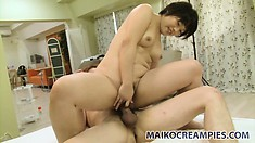 Akiko feeds her passion for cock and has him filling her twat with his warm juices
