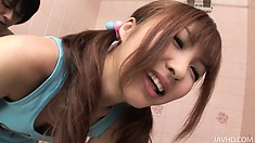 Cute asian teen keeps her top on while teasing her lover's cock