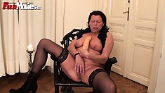 Horny and lustful mature lady with big tits pleases her pussy with a big dildo