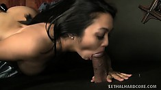 Busty Asian Mika strips for the priest then sucks his cock at the confessional gloryhole