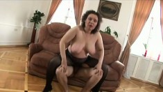 Lustful mature lady Andrea has a young guy taking care of her desires