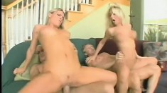Blonde bombshells Sammie and Harmony share two hard dicks on the couch